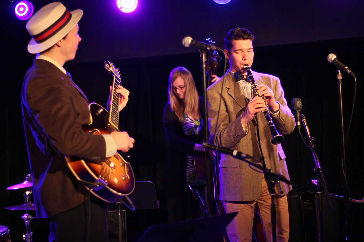 The Arntzen Brothers play the Bassment in Saskatoon. Evan Arntzen, right, was featured on the clarinet and saxophone, with his brother Arnt, left, holding it down on banjo and guitar (seen here). The brothers were joined by Jennifer Hodge on bass. Photo taken Tuesday, April 23, 2013.