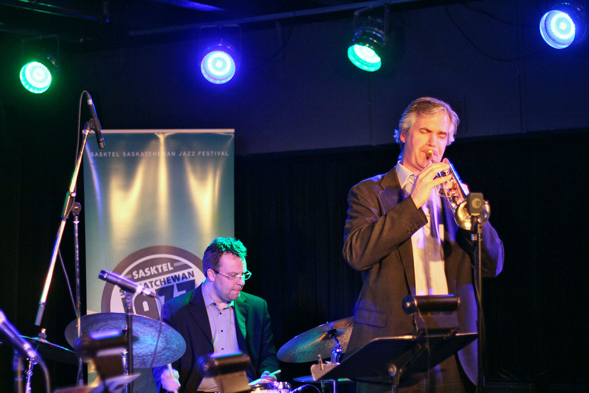 The Story of Jazz. Dean McNeill taking a solo, backed up by Jon McCaslin on drums. Photo taken Tuesday, April 30, 2013.