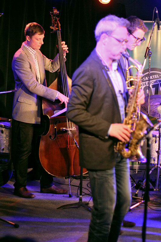 The Story of Jazz. Soren Nissen holds it down on the bass at the Story of Jazz. Photo taken Tuesday, April 30, 2013.