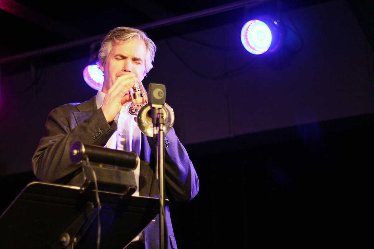 Dean McNeill takes a trumpet solo at the Story of Jazz.  Photo taken Tuesday, April 30, 2013.