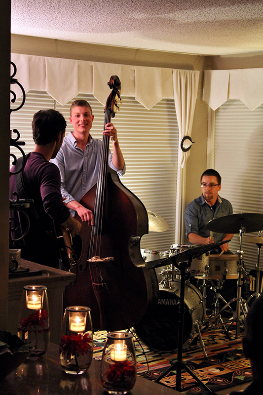 The Soren Nissen, Ian Wright and Nate Renner trio. Candles flicker in the foreground as the trio plays on. Photo taken Friday, May 17, 2013.
